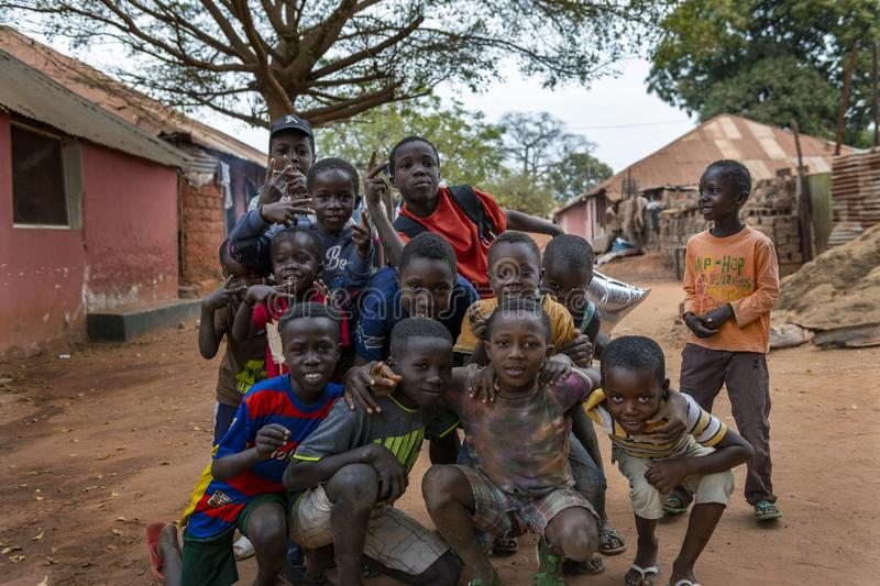 Group of children playing at the Missira neighborhood in the city of Bissau, Guinea Bissau. Bissau, Republic of Guinea-Bissau - February 6, 2018: Group of stock image