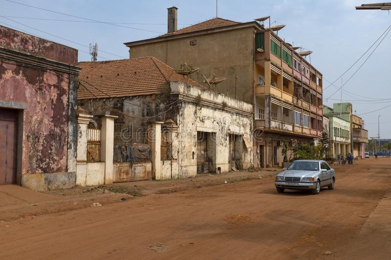 Street scene in the city of Bissau with a car on a street of Old Bissau Bissau Velho, in Guinea-Bissau royalty free stock image