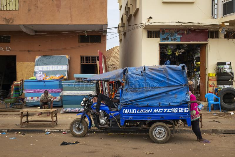 Street scene in the city of Bissau with people on a sidewalk and stores near the Bandim Market, in Guinea-Bissau. Bissau, Republic of Guinea-Bissau - February 6 royalty free stock image