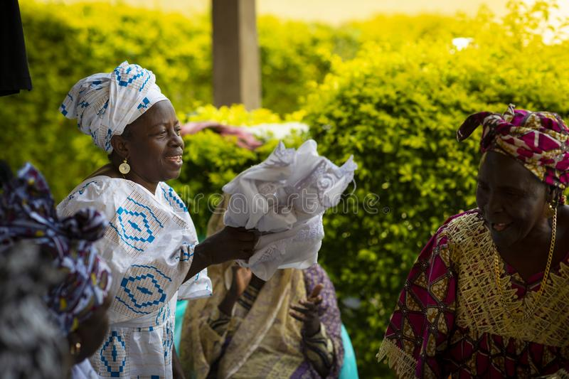 Group of women singing and dancing traditional songs at a community meeting in the city of Bissau, Guinea-Bissau. Bissau, Republic of Guinea-Bissau - January 31 royalty free stock photo