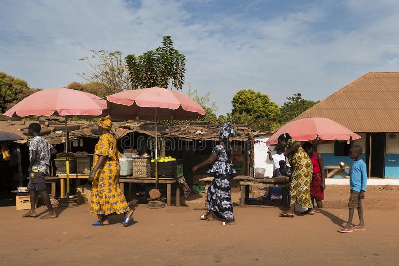 Street scene in the city of Bissau with women wearing colorful dresses in a street market, in Guinea-Bissau. Bissau, Republic of Guinea-Bissau - January 28, 2018 royalty free stock photography
