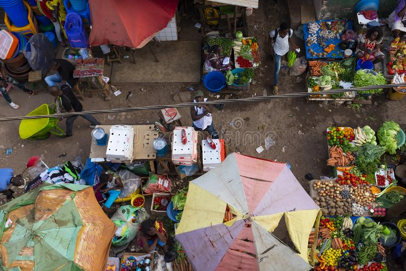 Vendors selling fruits and vegetables at the Bandim Market, in the city of Bissau. Bissau, Republic of Guinea-Bissau - January 30, 2018: Vendors selling fruits stock images