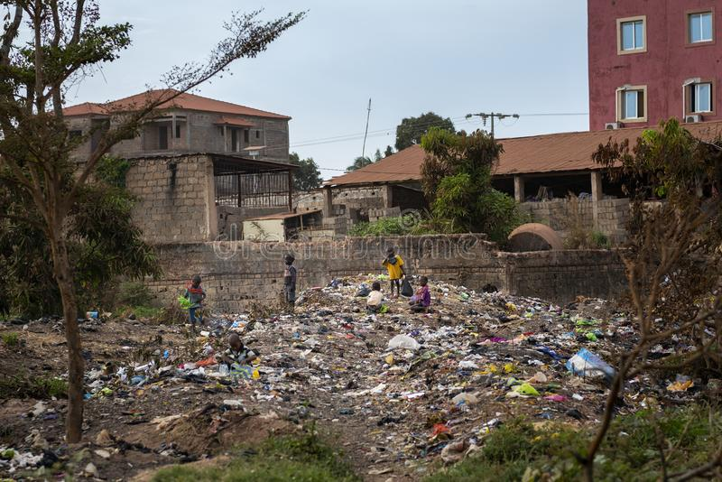 Group of children collecting garbage at a landfill in the city of Bissau, in Guinea-Bissau. Bissau, Republic of Guinea-Bissau - February 8, 2018: Group of royalty free stock photography