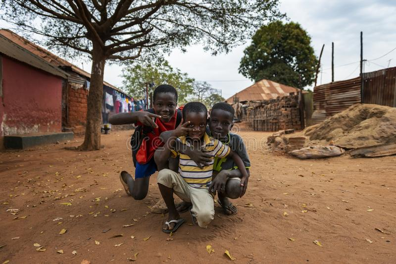 Group of children playing at the Missira neighborhood in the city of Bissau. Bissau, Republic of Guinea-Bissau - February 6, 2018: Group of children playing at stock photography