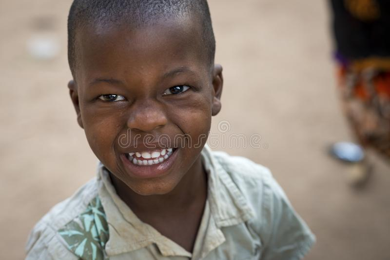 Portrait of young boy at the Bissaque neighborhood in the city of Bissau. Bissau, Republic of Guinea-Bissau - January 29, 2018: Portrait of young boy at the stock photos