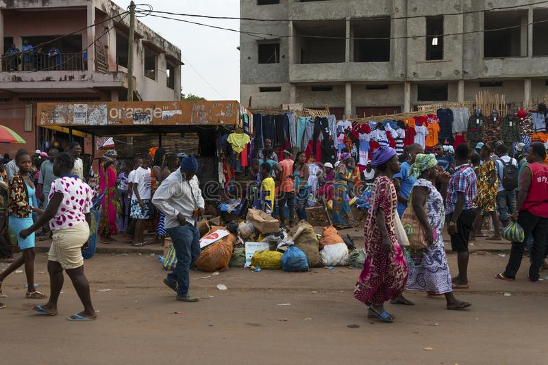 Street scene in the city of Bissau with people at the Bandim Market, in Guinea-Bissau. Bissau, Republic of Guinea-Bissau - January 28, 2018: Street scene in the royalty free stock images