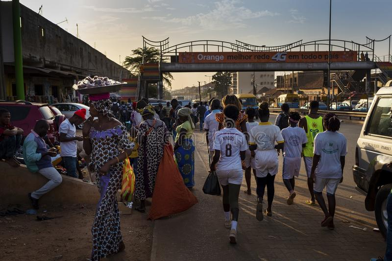 Street scene in the city of Bissau with people at the Bandim Market, in Guinea-Bissau. Bissau, Republic of Guinea-Bissau - January 30, 2018: Street scene in the stock photography