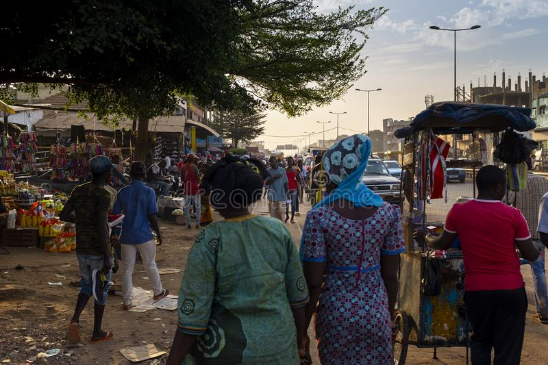 Street scene in the city of Bissau with people at the Bandim Market, in Guinea-Bissau, West Africa. Bissau, Republic of Guinea-Bissau - January 30, 2018: Street royalty free stock images