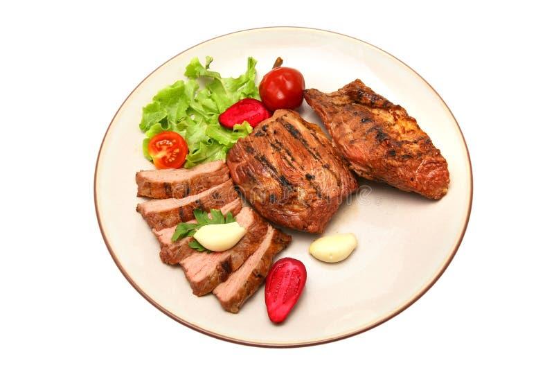 Bistecca arrostita servita della carne del manzo fotografia stock libera da diritti