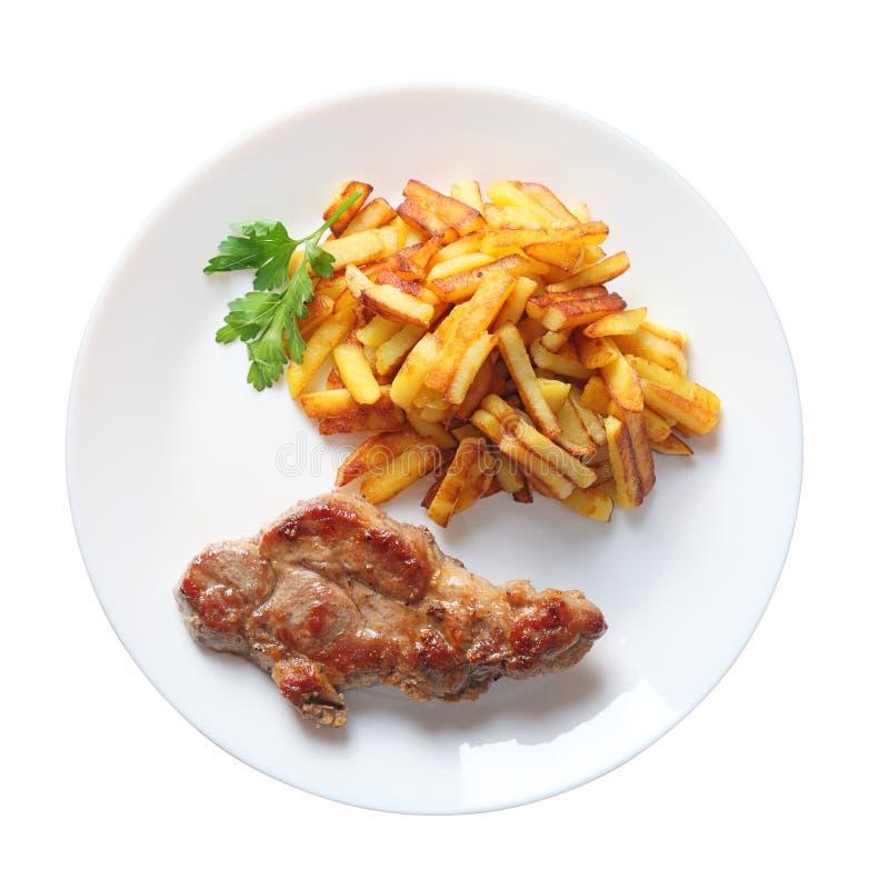 Bistecca con la vista superiore isolata patate fritta fotografia stock libera da diritti