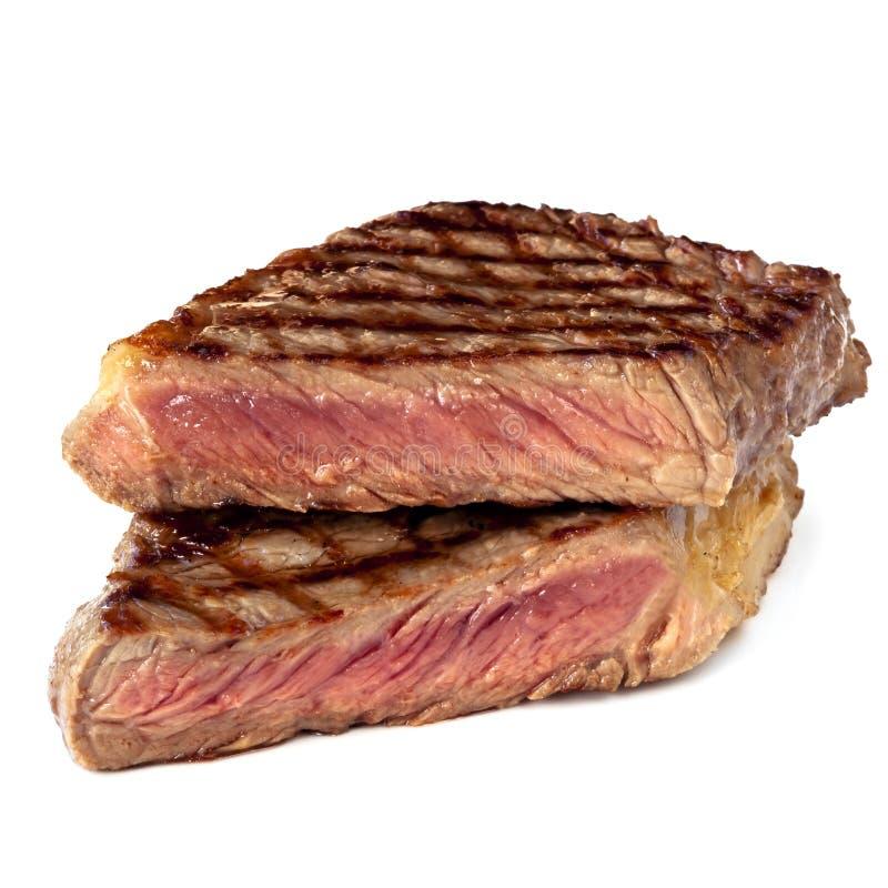 Bistecca cotta isolata su bianco immagine stock