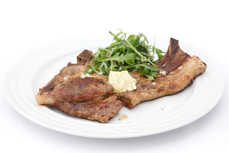 Bistecca di bistecca con l'osso della carne di maiale immagini stock libere da diritti