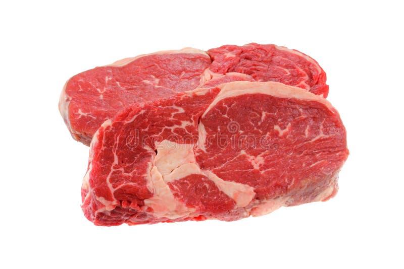 Bistecca di controfiletto fresca, isolata su un bianco immagine stock