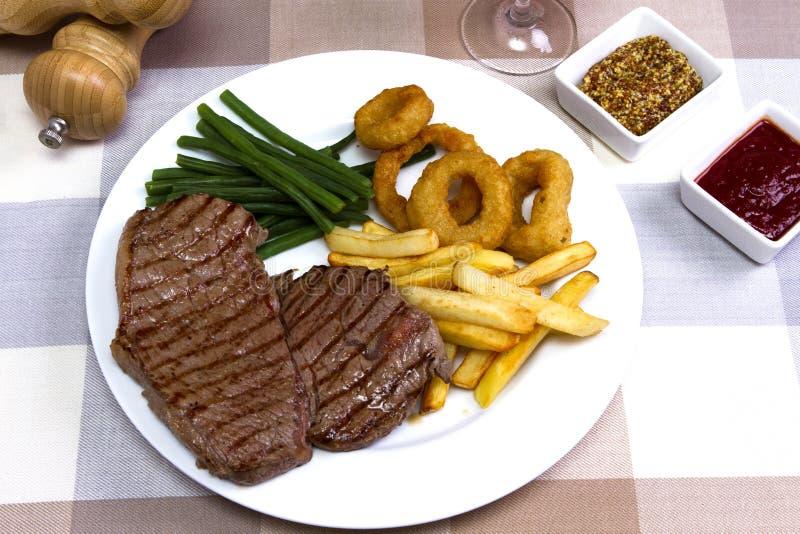 Download Bistecca di scamone immagine stock. Immagine di carboidrato - 56884811