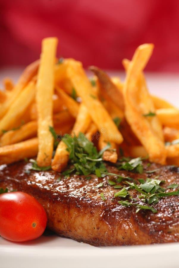 Bistecca e fritture fotografia stock libera da diritti