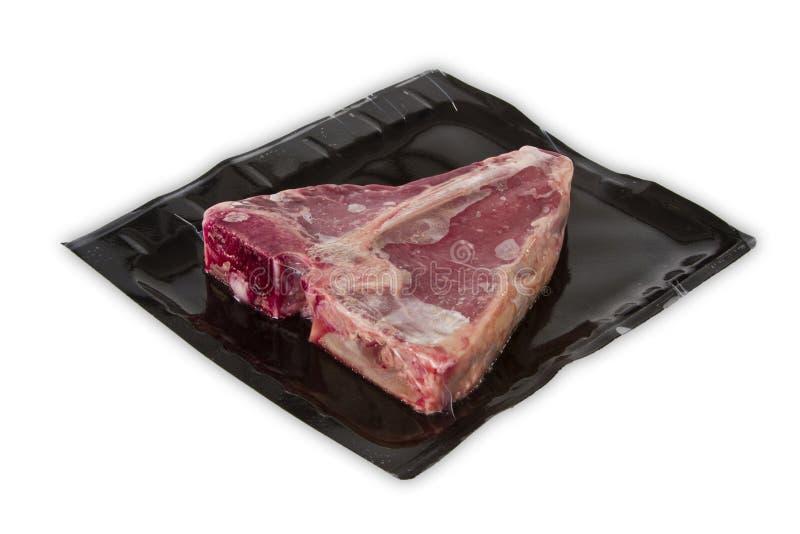 Bistecca nella lombata in imballaggio sotto vuoto fotografia stock libera da diritti