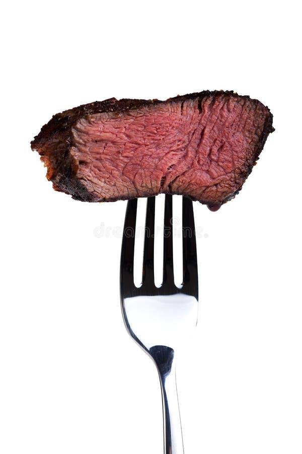 Bistecca su una forcella fotografia stock