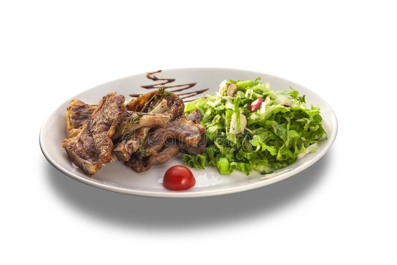 Bistecche arrostite e ortaggi freschi fotografia stock