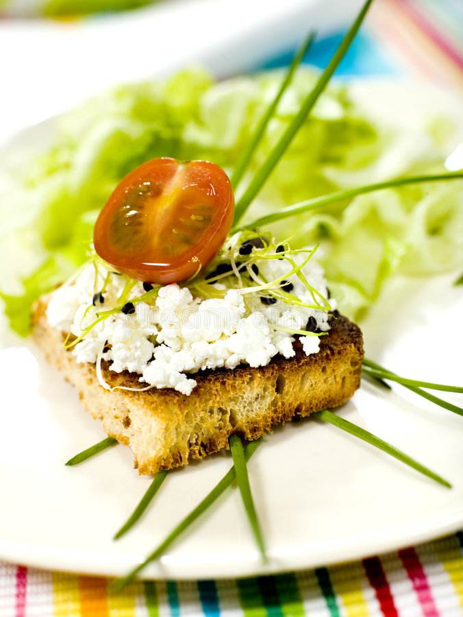 Bit. Sandwich with cottage cheese and fresh germs royalty free stock image