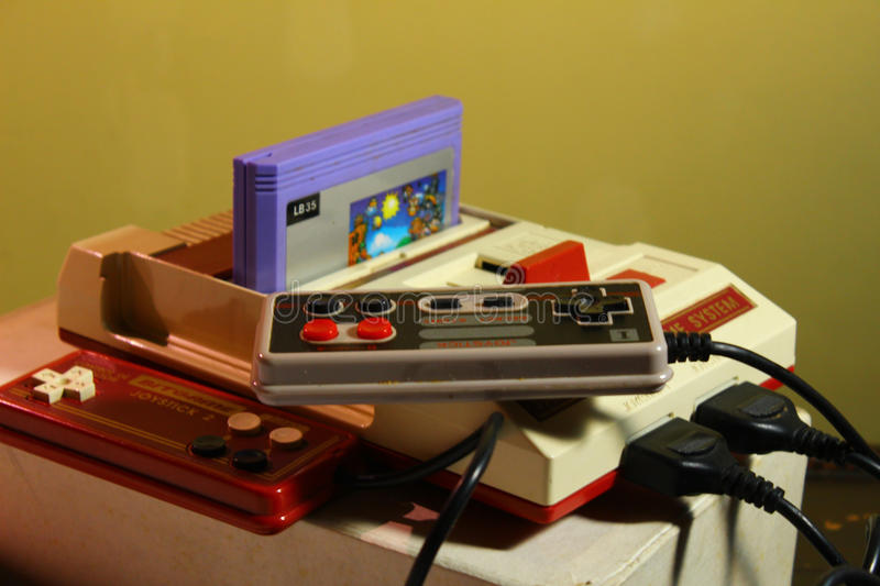 8 bit video game console with game nintendo stock photos