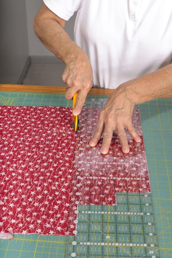 Bitande tyg för bruk i ett täcke fotografering för bildbyråer