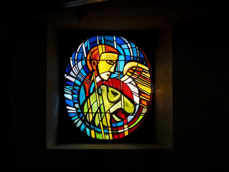 Stained glass window in a Bitburg church, Germany royalty free stock photo