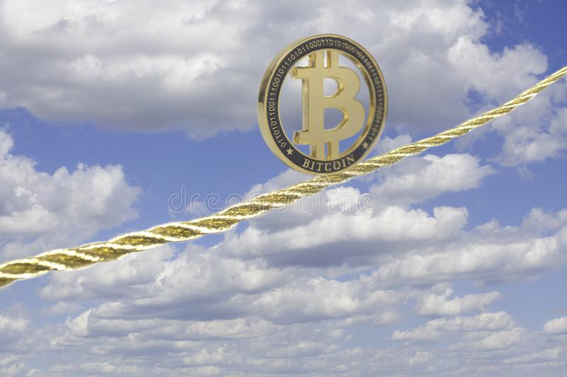 Bitcoin équilibrant sur la corde d'or photo stock