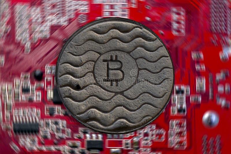 Bitcoin монетки ржаво На фоне видеокарты стоковое фото rf