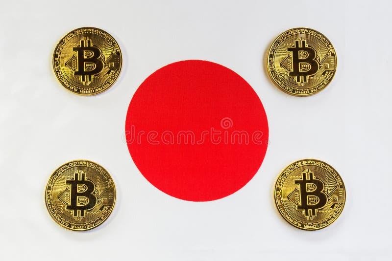 Bitcoin на флаге японца предпосылки стоковые фото