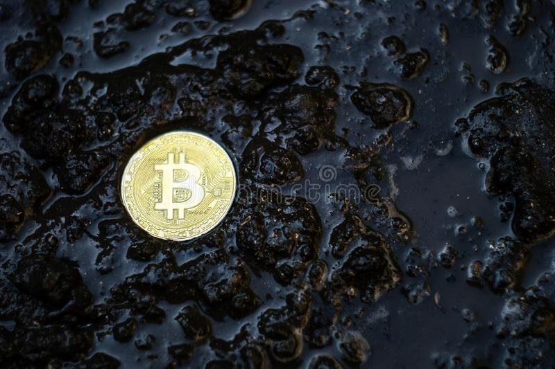 Bitcoin Abandoned In Mud, Lost And Forgotten Currency Concept.  royalty free stock photography