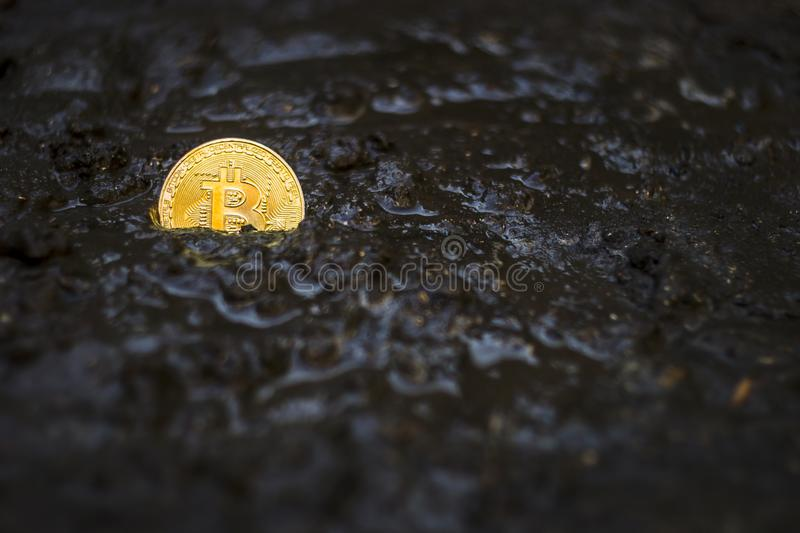 Bitcoin Abandoned In Mud, Lost And Forgotten Currency Concept.  royalty free stock image