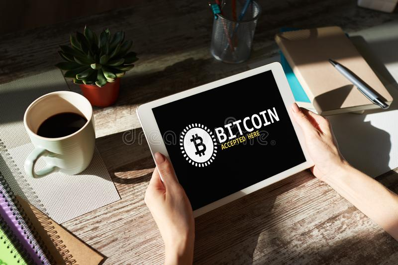 Bitcoin accepted here sign on screen. E-payment, Cryptocurrency and financial technology concept. Bitcoin accepted here sign on screen. E-payment stock photo