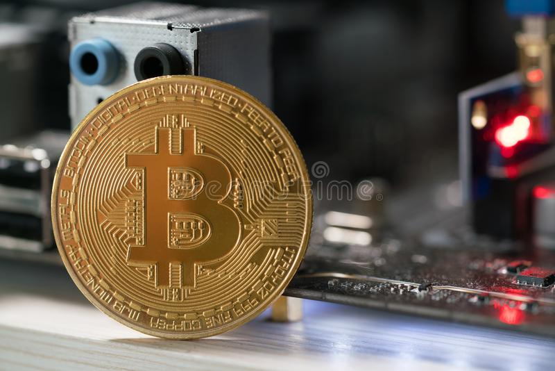 Bitcoin against the background of the motherboard in the rack for the crypto currency mining stock photos