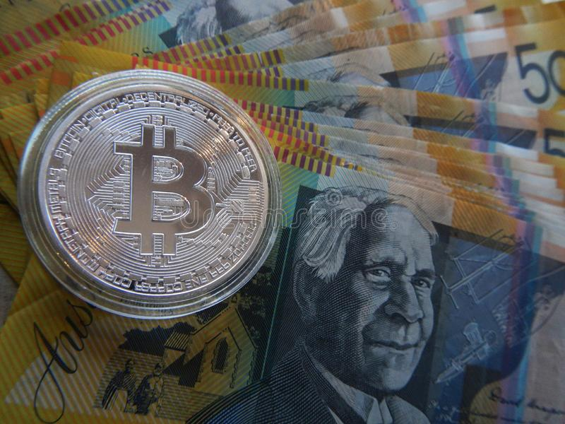 Bitcoin on Australian dollar. Silver cryptocurrency Bitcoin on Australian $50 dollar notes royalty free stock images