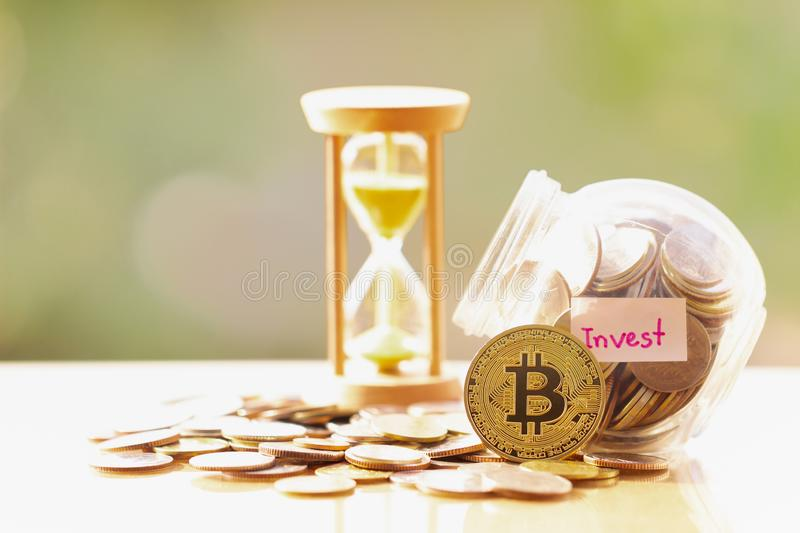 Bitcoin BTC Coins and on blurred greenery background. Bitcoin investments and taxes concept. virtual cryptocurrency concept. BTC,XRP,BCH,ETH,XMR royalty free stock photos