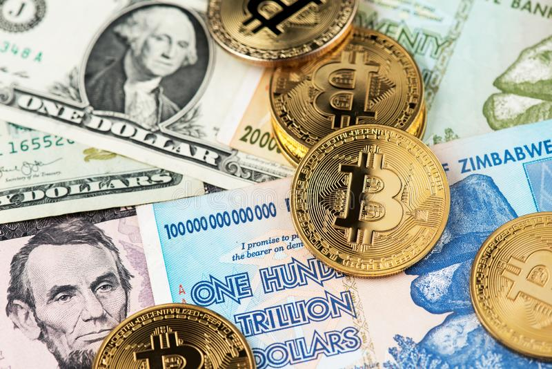 Bitcoin BTC cryptocurrency coins on Zimbabwe hyperinflation Dollar and US Dollar currency banknotes close up image. Africa. Bitcoin BTC cryptocurrency coins on royalty free stock photography