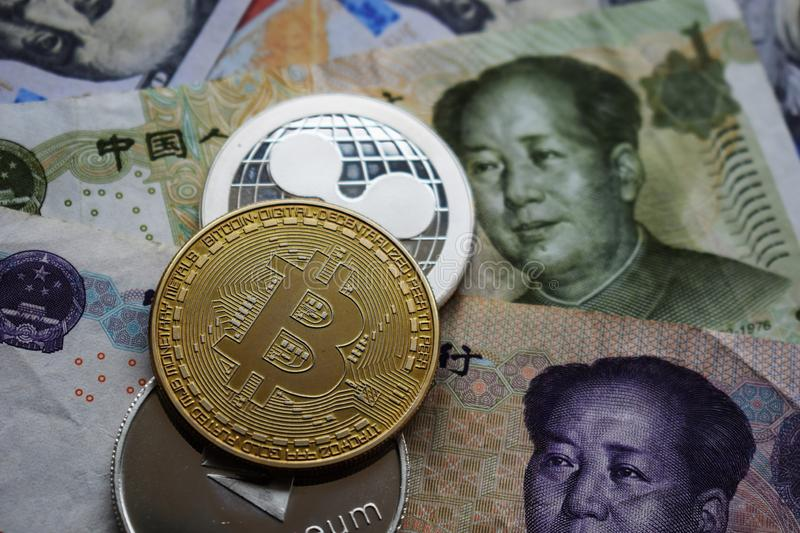 Bitcoin BTC and Ripple XRP Coins on Chinese Yuan. Close-up royalty free stock photography