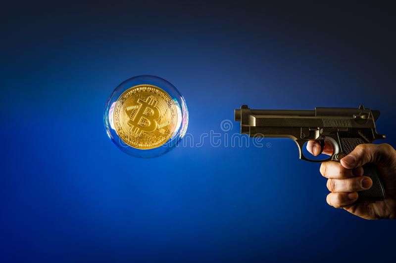 Bitcoin in a bubble with gun royalty free stock image
