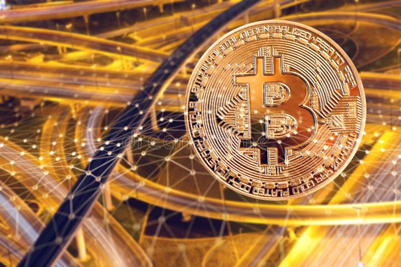 bitcoin and busy traffic in the background - futuristic smart city - cryptocurrency concept stock photo