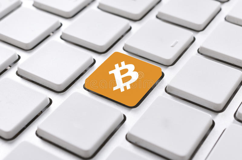 Bitcoin button. Selective focus on bitcoin button in the middle of keyboard stock photography