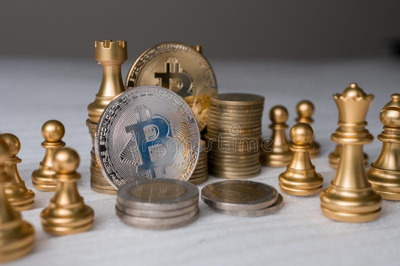 Bitcoin on chess board game of business ideas and blank space. Digital money Concept. Bitcoin on chess board game of business ideas and blank space for finance stock photos