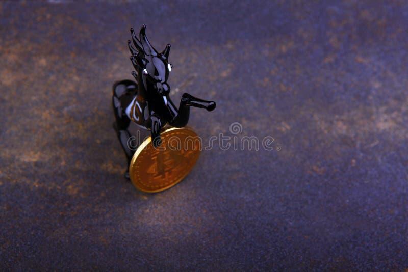 Bitcoin coin black horse stock images