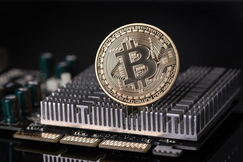 Bitcoin coin on cooler motherboard. Crypto currency. royalty free stock image