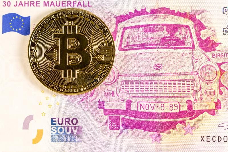 Bitcoin coin on the 0 euro bill lies. Crypto currency stock photography