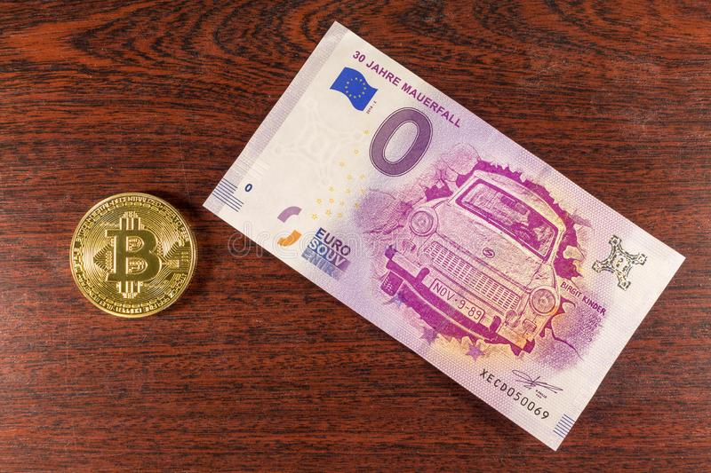 Bitcoin coin on the 0 euro bill lies. Crypto currency royalty free stock images