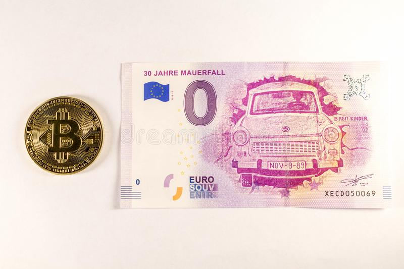 Bitcoin coin on the 0 euro bill lies. Crypto currency royalty free stock photo