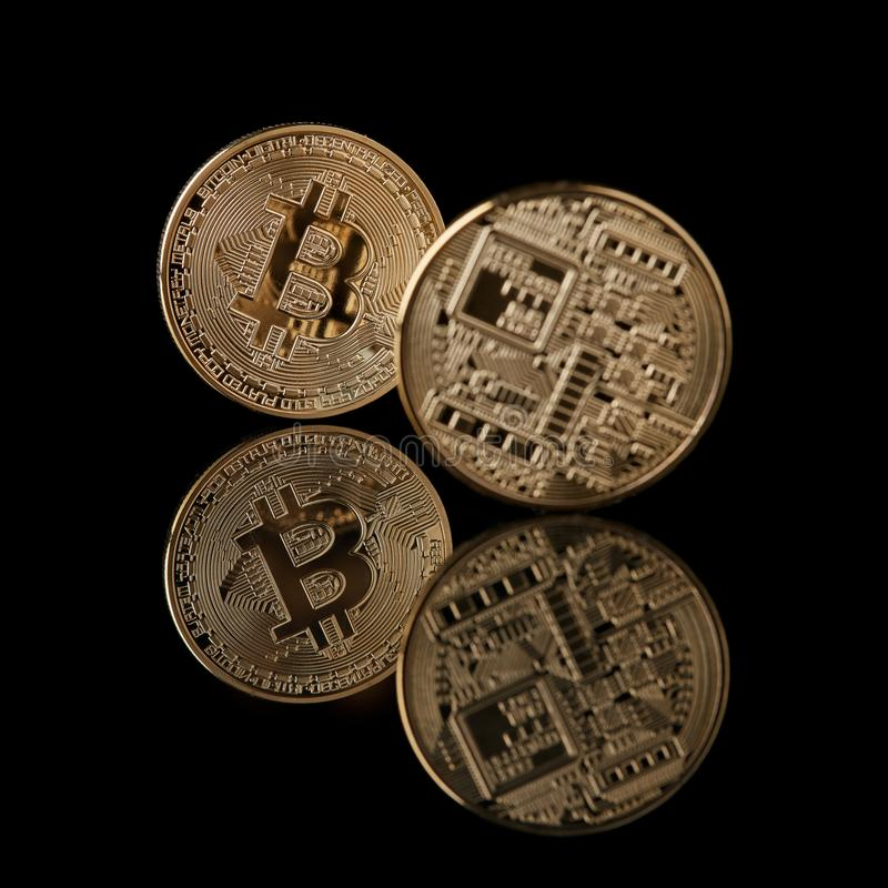 Face And Back Of The Crypto Currency Golden Bitcoin Stock