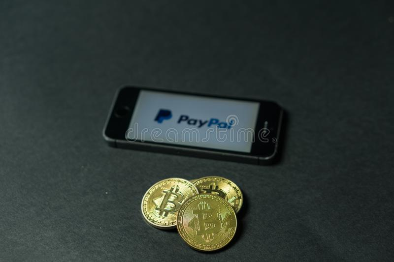Bitcoin coin with the Paypal logo on a phone screen, Slovenia - December 23th, 2018 stock photography