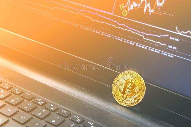 Bitcoin coin placed on modern black notebook. Close-Up photo Bitcoin , exchange virtual value, crypto digital money . Background Live Stock trading through stock photos