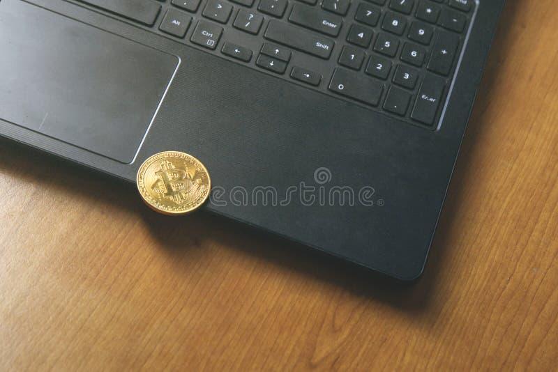 Bitcoin coin placed on modern black notebook . Close-Up photo Bitcoin , exchange virtual value, crypto digital money . Background Live Stock trading through stock photos
